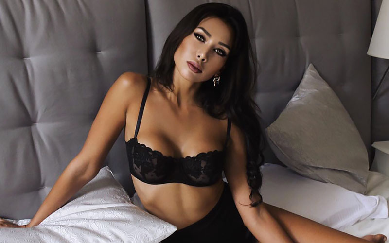 pretty latin woman on bed